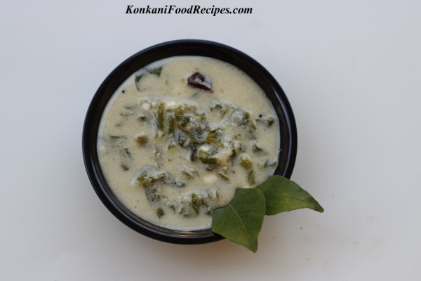 Malabar Spinach In Spicy, Tangy Coconut Chutney And Curds Gravy (Vali Mosuru Bajji)